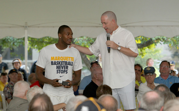 Steve Taylor receives his Elite 8 ring from Buzz Williams at the Marquette BBQ on June 26. (Marquette Images)