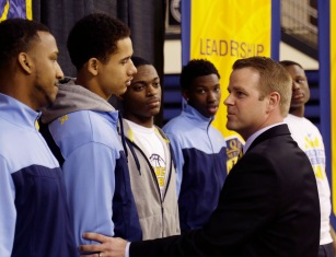 Steve Wojciechowski hasn't coached a game at Marquette, yet he's still 1-0. (AP)